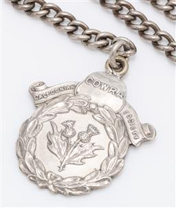 Sale 9180E - Lot 41 - An Angus & Coote sterling silver Cowra Caledonian society medal on chain, total weight 29.5g