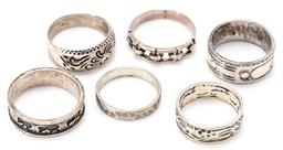 Sale 9164J - Lot 377 - SIX SILVER RINGS; engraved and pierced designs sizes Q, Q1/2, P1/2, R1/2, S1/2, & U1/2, total wt. 26.73g.