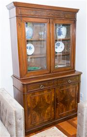 Sale 8308A - Lot 168 - An antique French figured walnut bookcase fitted with adjustable upper shelves and central locking drawers and a pair of quarter ven...