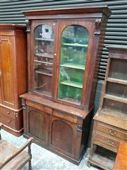 Sale 8792 - Lot 1026 - William IV / Victorian Mahogany Bookcase, with two arched astragal panelled doors above a long frieze drawer and two panelled doors...