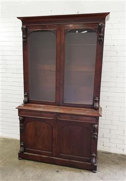 Sale 9097 - Lot 1023 - Good Victorian Mahogany Bookcase, with two arched glass panel doors flanked by corbels, above two oval panel drawers & two further t...