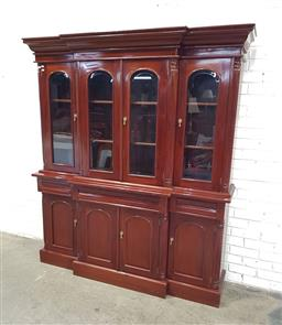 Sale 9121 - Lot 1002 - Reproduction Mahogany bookcase with four doors & three drawers below (h:210 w:185 d:48cm)