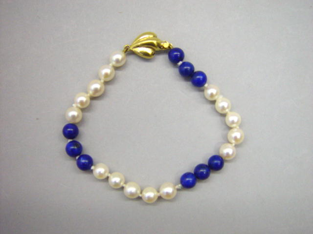 Sale 3545 - Lot 22 - A LAPIS LAZULI AND PEARL BRACELET;