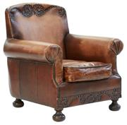 Sale 8261A - Lot 19 - The Studded Armchair, in brown top grain waxed leather with elaborate brass stud detail, and club feet, W 75 D76 H79cm