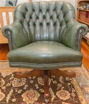 Sale 8308A - Lot 118 - An olive green deep buttoned and brass studded desk chair with a twisting and tilting action on 4 outswept legs on shepherd castors....