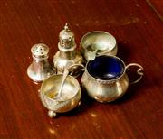 Sale 8418A - Lot 49 - A small group of silver cruet wares including a baluster pepper pot (Birmingham) cap stand salt, two cauldron shaped open salts (Vic...