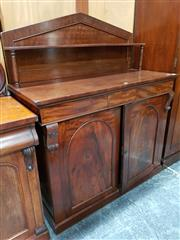 Sale 8792 - Lot 1010 - Late Regency Mahogany Chiffonier, the tympanum back with shelf, above two frieze drawers and two panelled doors, enclosing a cellare...