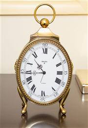 Sale 8774A - Lot 254 - A bedside clock by Swiza together with a brass effect lamp