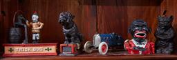 Sale 9103H - Lot 6 - A collection of five cast iron money boxes including trick dog and racing car etc, Tallest 17cm