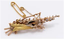 Sale 9180E - Lot 102 - A two tone 14ct and 9ct gold lily brooch with seed pearls, some losses, weight 4g, Length 4.5cm