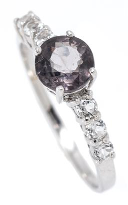 Sale 9164J - Lot 483 - A SPINEL AND TOPAZ RING; set in silver with a round cut greyish purple spinel to shoulders set with 6 round cut white topaz, width 6...