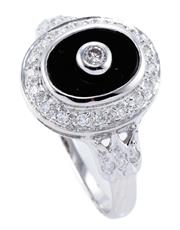 Sale 8915 - Lot 355 - A DECO STYLE 9CT WHITE GOLD ONYX AND DIAMOND RING; oval onyx plaque centre set with a round brilliant cut diamond, to surround and s...