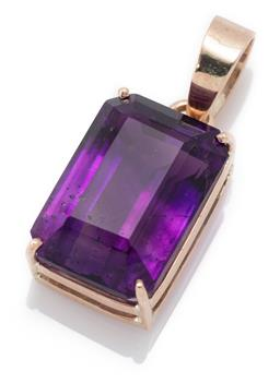 Sale 9186 - Lot 357 - A 9CT GOLD AMETHYST PENDANT; featuring an emerald cut amethyst of approx. 13ct, size 27 x 12mm, wt. 4.75g.