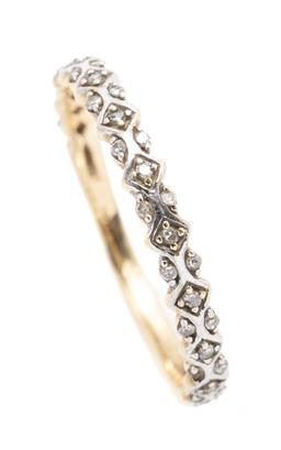Sale 9253J - Lot 531 - A 10CT GOLD DIAMOND ETERNITY RING; 2.6mm wide band 3/4 hoop set with single cut diamonds (2 missing), size M 1/2, wt. 1.1g.