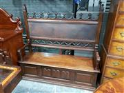 Sale 8792 - Lot 1016 - 19th Century Probably French Carved Walnut Gothic Style Settee or Hallseat, the leather upholstered back flanked by Gothic flourishe...