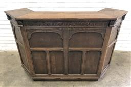 Sale 9126 - Lot 1179 - English Carved Oak Bar, in the early 18th century style, with arcaded panels & small wings, some shelves to back (h:107 w:162 d:51cm)