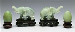 Sale 9138 - Lot 151 - Pair of Soapstone Elephants (H:11cm L:12cm) together with a Pair of Greenstone Eggs on Stands (H:9cm)