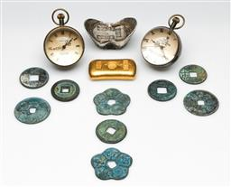 Sale 9190 - Lot 77 - A collection of reproduction ingots and tokens together with two reproduction ball clocks (H:5cm)