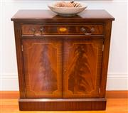 Sale 8308A - Lot 6 - An English mahogany side cabinet. The flame top satinwood strung with contrasting edge banding. The full length cocked bead drawer w...
