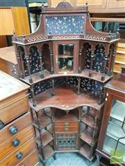 Sale 8416 - Lot 1023 - An Edwardian Mahogany Corner Cabinet with Eastern influences, mirrors and silk butterfly backing