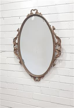 Sale 9102 - Lot 1099 - Ornate oval metal framed mirror - chip to glass (h86cm)