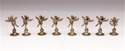 Sale 9107 - Lot 98 - A group of eight silver plated menu or place name holders in winged cherub form. Height 5.5cm