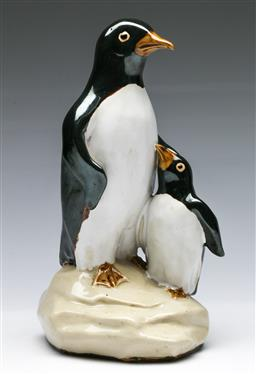 Sale 9168 - Lot 92 - A studio pottery figural group of two penguins - marked to base (H:24.5cm)