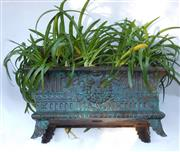 Sale 8256A - Lot 6 - An antique French cast iron garden jardinière planted with agapanthus. Overall size: 60 x 28 x 32 cm