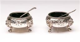 Sale 9110 - Lot 14 - A pair of Victorian sterling silver open salts and spoons, sitting on three lions feet with cobalt-blue glass liners c1873