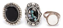 Sale 9164J - Lot 321 - THREE VINTAGE SILVER STONE SET RINGS; one with opal and stone pieces, size N, top 27 x 19mm, an Egyptian onyx plaque set (chip) adju...