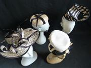 Sale 7982B - Lot 90 - Four monochromatic fascinators; two are Gregory Ladner, one Ward and Wylie, one Phipps