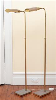 Sale 9055H - Lot 16 - A pair of brass height-adjustable reading lamps (pitted). H:135cm.