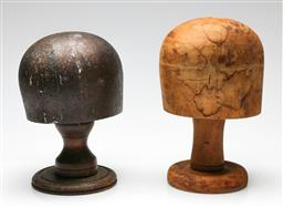 Sale 9209 - Lot 62 - A set of two timber hat blocks (H:25cm and 28cm)