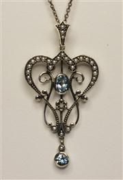 Sale 8036A - Lot 333 - A STERLING SILVER ART NOUVEAU STYLE TOPAZ PENDANT NECKLACE; scrolling frame set with blue topaz and seed pearls on fine silver chain..