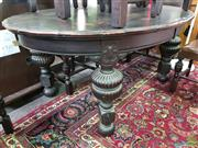 Sale 8589 - Lot 1078 - Ebonised Dining Table on Turned Legs with Two Leaves