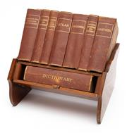 Sale 8864 - Lot 26 - Miniature Reference Library of Atlas, Gazateer, Reference and Dictionaries contained in a timber rack