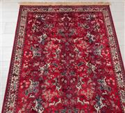 Sale 9023H - Lot 21 - A Qum style hunting scene floor rug with horsemen on a red background 200x 138cm.