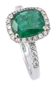 Sale 9066A - Lot 57 - AN 18CT WHITE GOLD EMERALD AND DIAMOND RING; centring on a cushion cut emerald of approx. 1.60ct (some surface cracks), to surround...