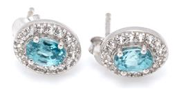 Sale 9164J - Lot 421 - A PAIR OF ZIRCON AND TOPAZ CLUSTER STUD EARRINGS; each set with an oval cut blue zircon to surround of white topaz in silver, width...