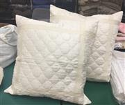 Sale 8310A - Lot 399 - A pair of square ivory quilted pillow cases with inserts