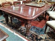 Sale 8848 - Lot 1098 - Victorian Mahogany Extension Dining Table, with two leaves and push-pull mechanism, on turned reeded legs with ceramic castors