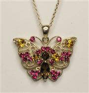 Sale 8036A - Lot 355 - A STERLING SILVER GEM SET BUTTERFLY PENDANT; set with pink topas, smokey quartz and citrine to fine silver chain (2.9cm)