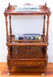 Sale 8308A - Lot 24 - A superior antique English burr walnut music canterbury. The platform top with reticulated carved sides. The boxwood stringing enhan...