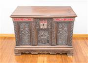 Sale 8338A - Lot 118 - An antique gothic style carved walnut chest, the central panel with an armorial, with iron mounts with red velvet backing, H 57 x W...