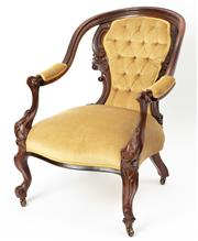 Sale 8960J - Lot 29 - An antique English armchair carved in Brazilian Rosewood C: 1850, the deep buttoned back and shaped seat upholstered in soft gold ve...