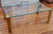 Sale 9055H - Lot 20 - A brass and glass coffee table (pitted). H:45cm W:124cm D:72cm