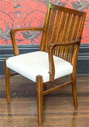 Sale 8222 - Lot 11 - A timber slat back armchair with white upholstered seat and brass stud detail, H 66cm Film Provenance; Australia, 2008