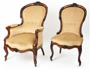 Sale 8960J - Lot 25 - An exceptional pair of antique carved rosewood sitting room chairs C: 1850. The rose carved backs flanked by C scrolls, Kingwood a...