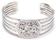 Sale 9066A - Lot 1 - A SILVER CUFF BANGLE; tapered 5 row bangle applied with plaques embossed with floral motifs, width 25.6 - 15.6mm, internal width 62m...