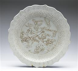 Sale 9098 - Lot 166 - Carved phoenix themed porcelain charger with bamboo themed border (d:42.5cm)